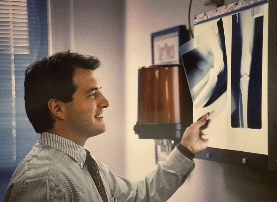 Jack Henzes looking at an X-Ray in 1995